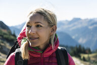 Austria, Tyrol, portrait of smiling woman on a hiking trip in the mountains - UUF16348
