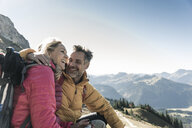 Austria, Tyrol, happy couple having a break during a hiking trip in the mountains - UUF16360