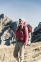Austria, Tyrol, smiling woman on a hiking trip in the mountains - UUF16372