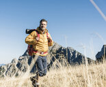 Austria, Tyrol, man hiking in the mountains - UUF16378