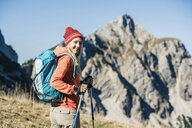 Austria, Tyrol, smiling woman on a hiking trip in the mountains - UUF16408