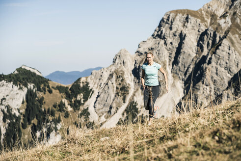 Austria, Tyrol, woman running in the mountains - UUF16417