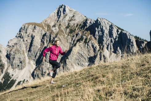 Austria, Tyrol, woman running in the mountains - UUF16426