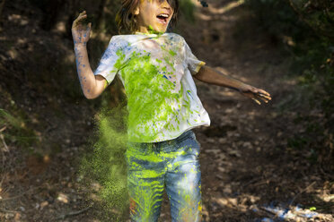 Boy full of colorful powder paint, celebrating Holi, Festival of Colors - ERRF00455