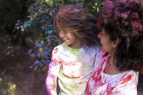 Mother and son full of colorful powder paint, celebrating Holi, Festival of Colors - ERRF00461
