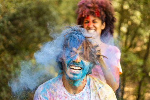 Happy couple celebrating Holi, Festival of Colors - ERRF00467