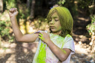 Boy full of colorful powder paint, celebrating Holi, Festival of Colors - ERRF00485