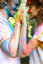Affectionate couple celebrating Holi, Festival of Colors - ERRF00509