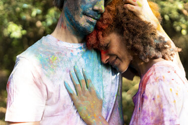 Affectionate couple celebrating Holi, Festival of Colors - ERRF00515