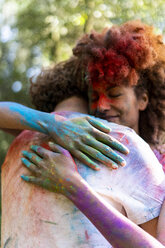 Affectionate couple celebrating Holi, Festival of Colors - ERRF00521