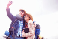 Backpacker couple taking selfie - CUF46571