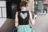 Tattooist in parlour - CUF46622