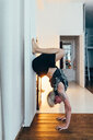 Woman practising yoga at home - CUF46664