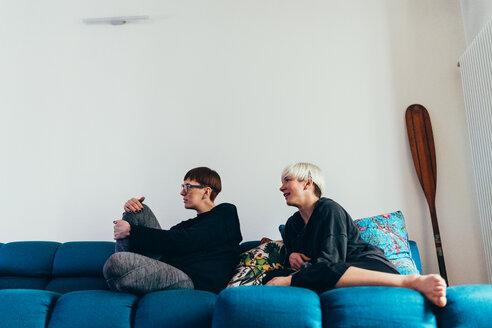 Women sitting on sofa - CUF46667