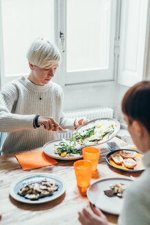 Girlfriends having lunch at home - CUF46676