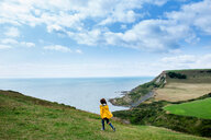 Boy on clifftop looking out to sea, Bournemouth, UK - CUF46727