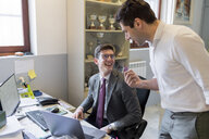 Colleagues laughing in office - CUF46733