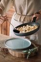 Potato gnocchi in frying pan being served - CUF46853