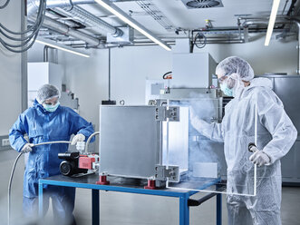 Chemists working in industrial laboratory clean room - CVF01102