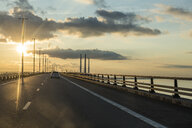 Sweden, Malmoe, Sunset over Oresund bridge - RUNF00950