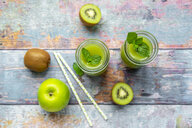 Two glass bottles of apple kiwifruit smoothie - SARF04050
