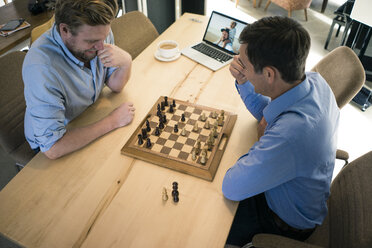 Top view of two men playing chess - JOSF02828