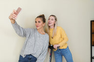 Girlfriends taking smartphone selfies - VABF02174