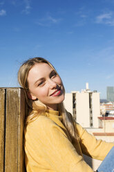 Young woman relaxing on an urban rooftop terrace - VABF02207