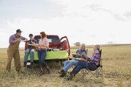 Multi-generation family enjoying lunch in crop field - HEROF04763