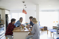 Couples playing cards at kitchen island - HEROF05063