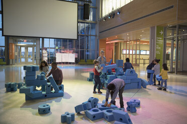 Children stacking large pieces in science center - HEROF05168