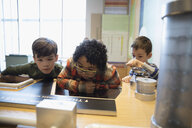 Curious boys watching exhibit in science center - HEROF05186