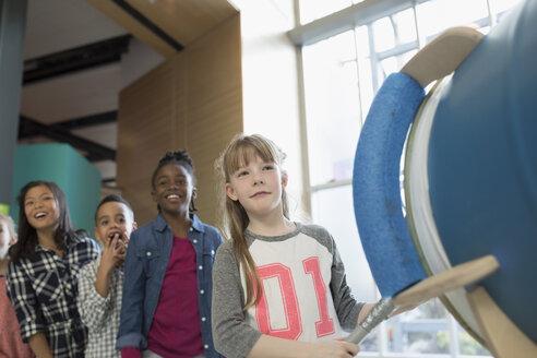 Children watching cloud cannon in science center - HEROF05225