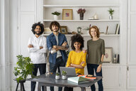 Group of creative professionals stnading in their new office space - AFVF02251