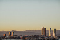 Spain, Madrid, cityscape with modern skyscrapers at twilight - JCMF00038