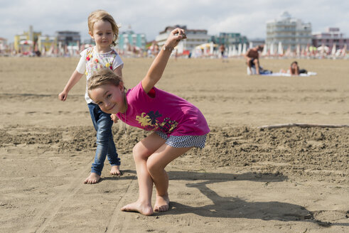 Two playful little girls on the beach - PSIF00215
