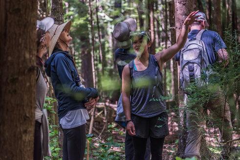 Friends hiking in forest, Johnstone Strait, Telegraph Cove, Canada - CUF46948