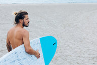 Surfer with surfboard by seaside - CUF46957