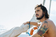 Man on sailboat - CUF46963