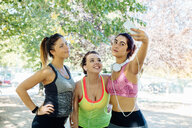 Friends exercising and taking selfie in park - CUF47002