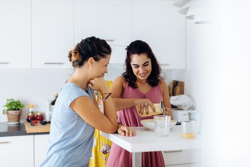 Friends preparing lunch in kitchen - CUF47014