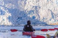 Man kayaking near glacier, Narsaq, Vestgronland, Greenland - CUF47020