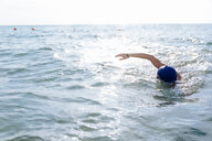 Man swimming in sea - CUF47041