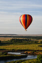 Air balloon floating over Mara River, Kenya - CUF47095