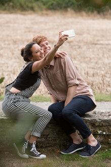 Friends taking selfie in countryside - CUF47200