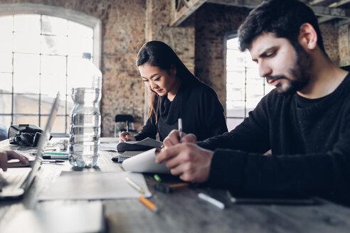 Designers brainstorming in studio - CUF47287