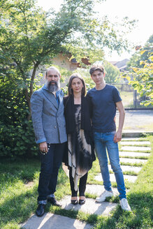 Couple with son in garden - CUF47356