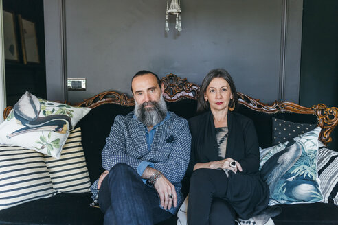 Couple sitting on antique sofa - CUF47359