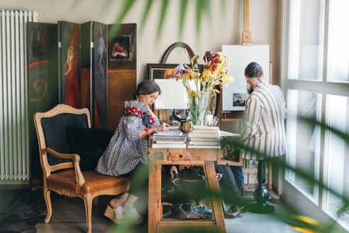 Couple working in their studio - CUF47377