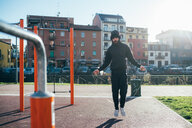 Man skipping in outdoor gym - CUF47383